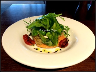 Melted Goat cheese, eggplant, tomato, herb salad