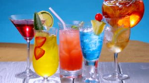 stock-footage-several-colorful-summer-drinks-on-table-as-iced-tea-is-poured-into-a-glass-shot-in-hd-video