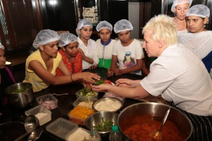 Underprivileged girls cooking with international Michelin chefs as part of CSSG initiative to train them to become chefs